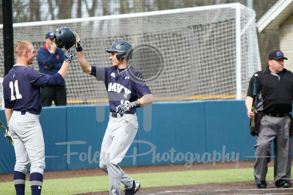 Navy Midshipmen outfielder Logan Knowles (19) Navy Midshipmen outfielder Evan Lowery (11)