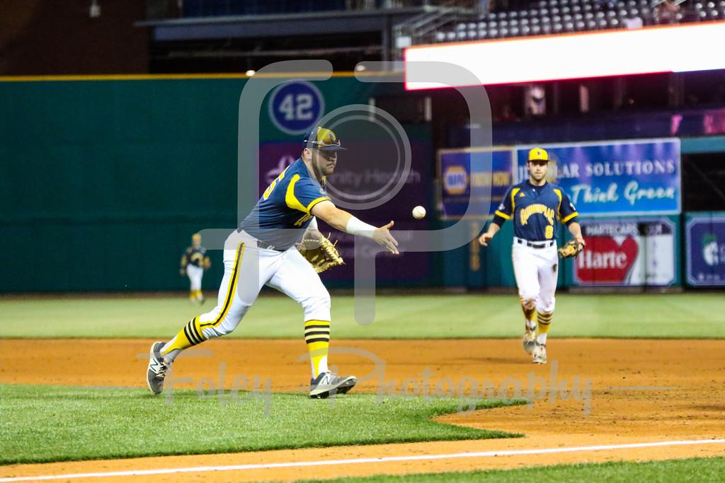 Quinnipiac first baseman Liam Scafariello (25) Quinnipiac pitcher Brandon Shileikis (34)