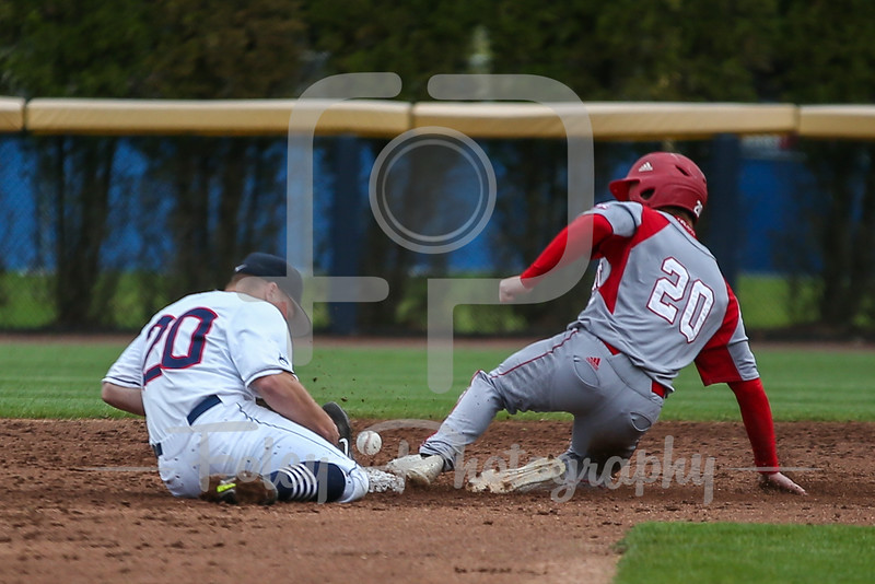 Sacred Heart outfielder Anthony Capozziello (20) Connecticut Huskies infielder Conor Moriarty (20)