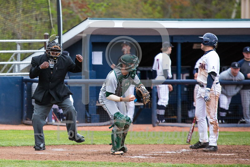 Umpire Harry Greer Connecticut Huskies infielder Anthony Prato (1)