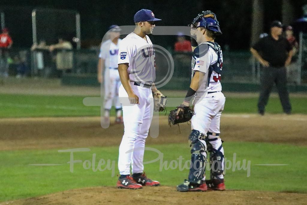 USA Collegiate National Team Dallas Woolfork (26) USA Collegiate National Team catcher Grant Koch (33)