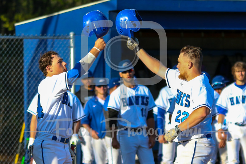 Becker College Hawks first baseman Nick Harriman (22) Becker College Hawks third baseman Michael Bianco (44)