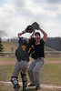 NR's pitcher Jacob Theis (20) and catcher Will Hershman (44) collide as they both attempt to catch a fly ball in foul territory. Theis held on to the ball for the put out.