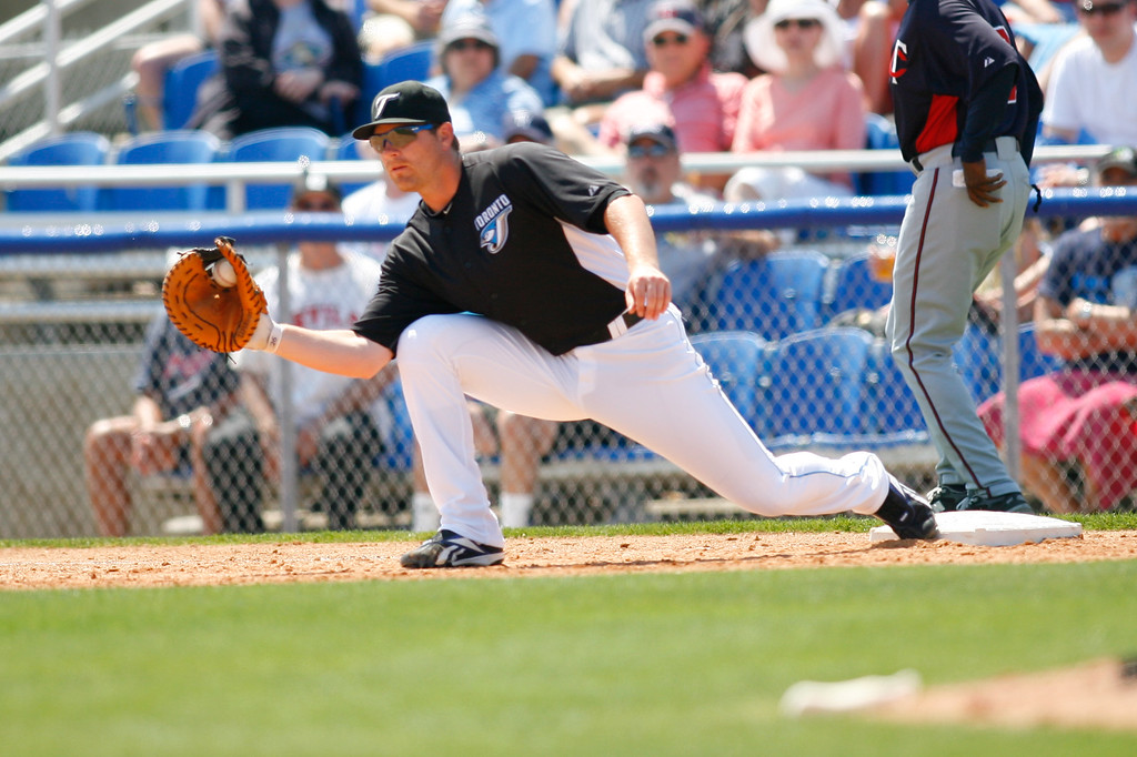 Toronto Blue Jays first baseman Adam Lind (26) makes the play at first during a Grapefruit League Spring Training Game at the Florida Auto Exchange Stadium.