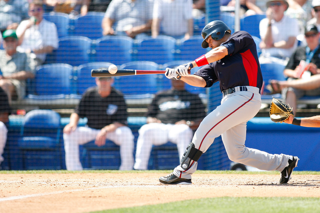 Minnesota Twins right fielder Jason Repko (18) hits a line drive foul during a Grapefruit League Spring Training Game at the Florida Auto Exchange Stadium.
