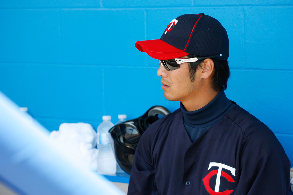 Minnesota Twins second baseman Tsuyoshi Nishioka (1) rests in the dug out during a Grapefruit League Spring Training Game at the Florida Auto Exchange Stadium.