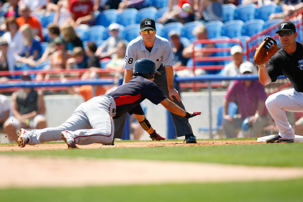 Minnesota Twins second baseman Tsuyoshi Nishioka (1) dives back to first during a Grapefruit League Spring Training Game at the Florida Auto Exchange Stadium.