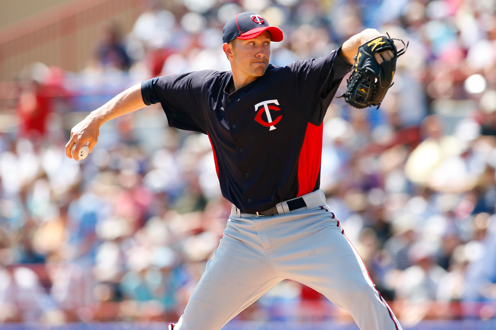 Minnesota Twins starting pitcher Scott Baker (30) winds up for a pitch during a Grapefruit League Spring Training Game at the Florida Auto Exchange Stadium.