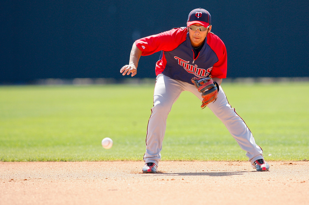 Minnesota Twins second baseman Tsuyoshi Nishioka (1) fields a ground ball during batting practice prior to a Grapefruit League Spring Training Game at the Florida Auto Exchange Stadium.