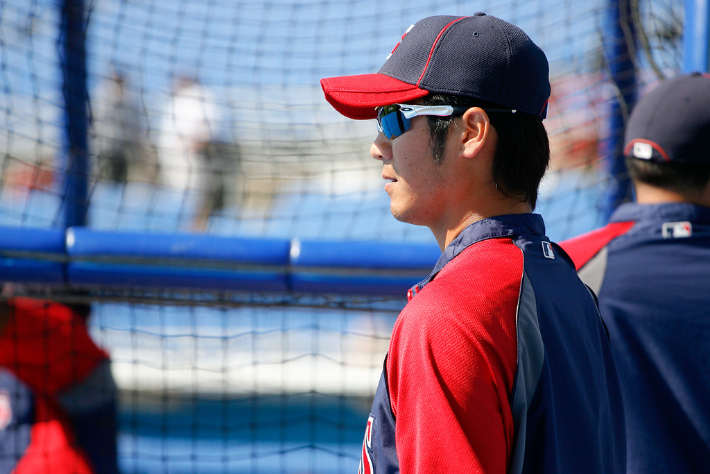 Minnesota Twins second baseman Tsuyoshi Nishioka (1) watches batting practice during a Grapefruit League Spring Training Game at the Florida Auto Exchange Stadium.