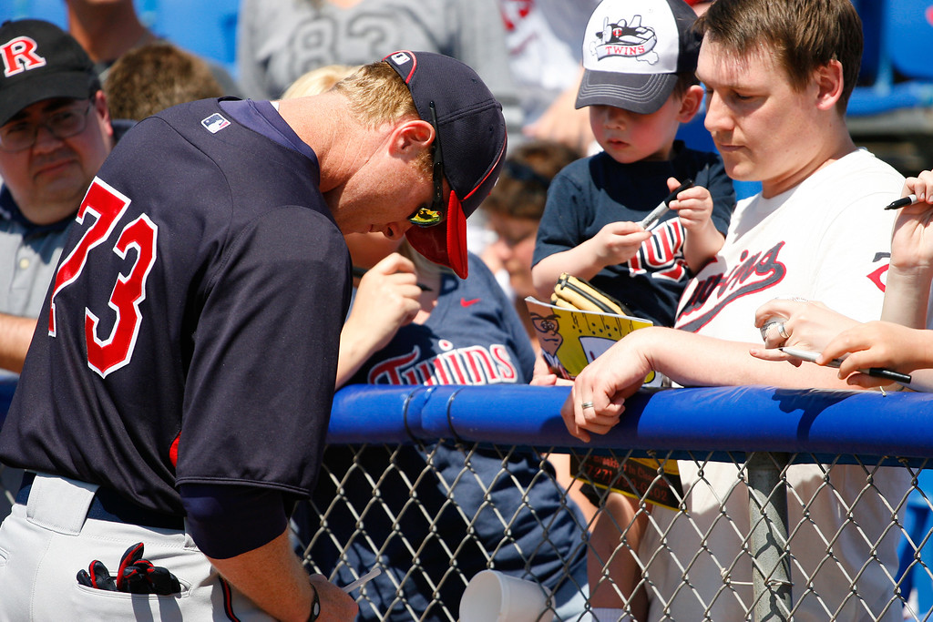 Minnesota Twins relief pitcher Carlos Gutierrez (72) signs for fans during a Grapefruit League Spring Training Game at the Florida Auto Exchange Stadium.