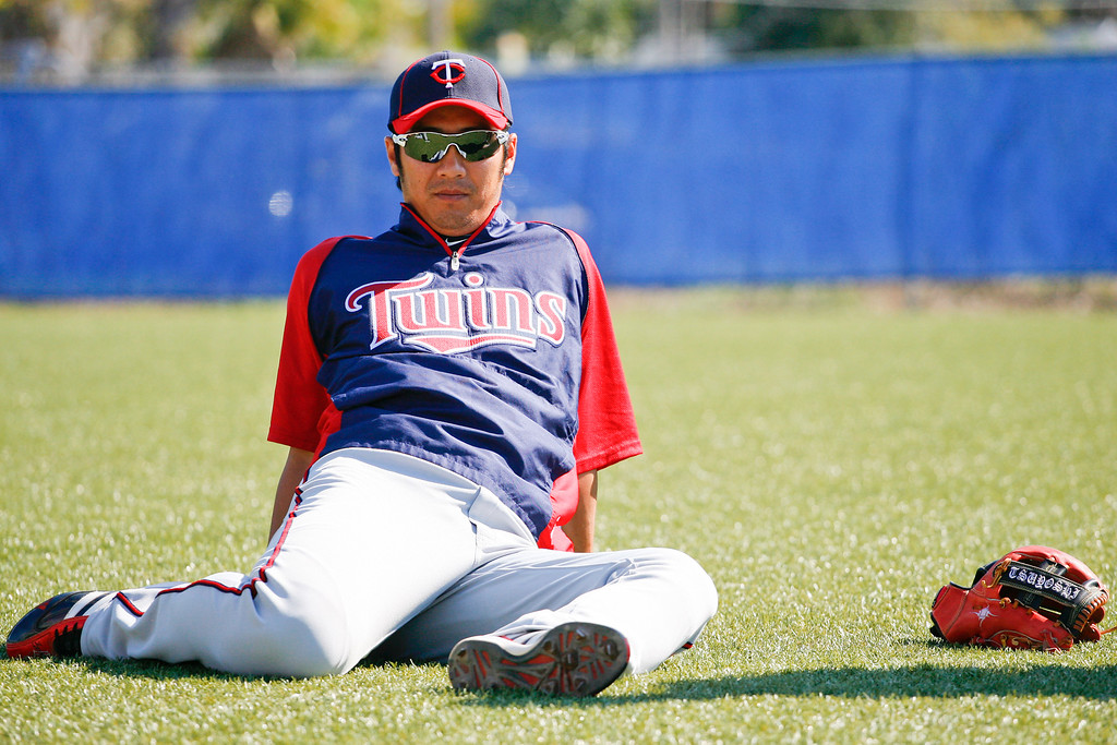 Minnesota Twins second baseman Tsuyoshi Nishioka (1) stretches prior to a Grapefruit League Spring Training Game against the Toronto Blue Jays at the Florida Auto Exchange Stadium.