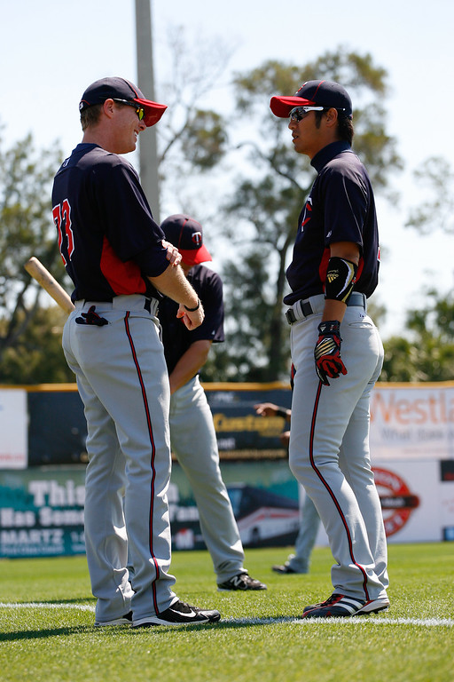 Minnesota Twins second baseman Tsuyoshi Nishioka (1) chats with a teammate during a Grapefruit League Spring Training Game at the Florida Auto Exchange Stadium.