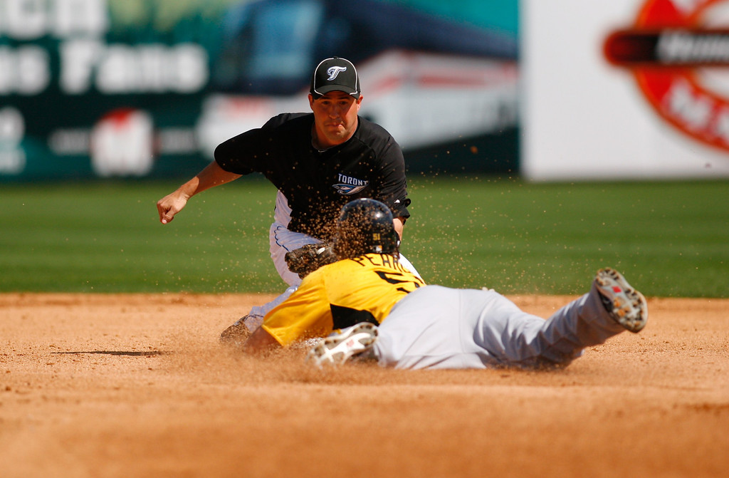 Pittsburgh Pirates first baseman Steve Pearce (51) dives into second base during a Grapefruit League Spring Training Game at the Florida Auto Exchange Stadium.