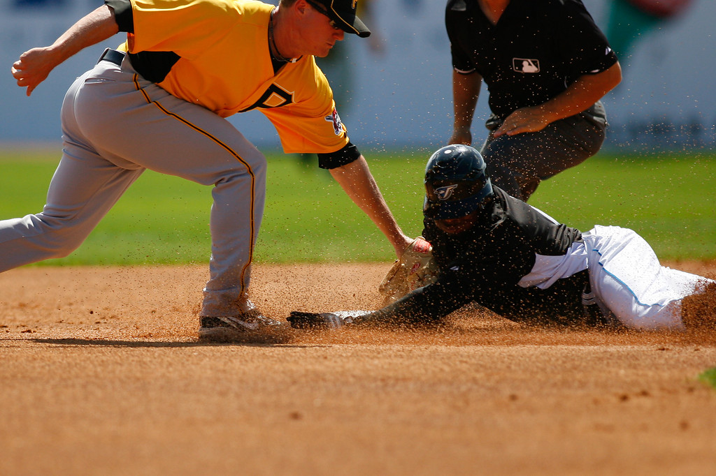 Pittsburgh Pirates 2B Brian Friday (77) attempts to tag out Toronto Blue Jays OF Rajai Davis (11) at second base during a Grapefruit League Spring Training Game at the Florida Auto Exchange Stadium.