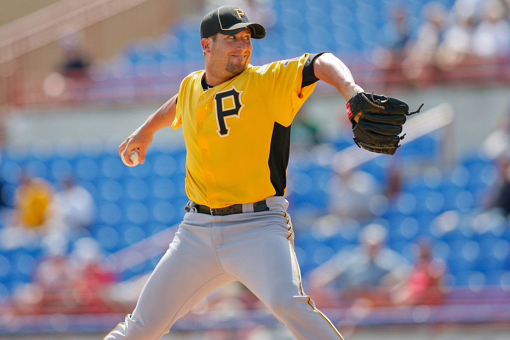 Pittsburgh Pirates starting pitcher Brad Lincoln (32) wind sup for a pitchduring a Grapefruit League Spring Training Game at the Florida Auto Exchange Stadium.