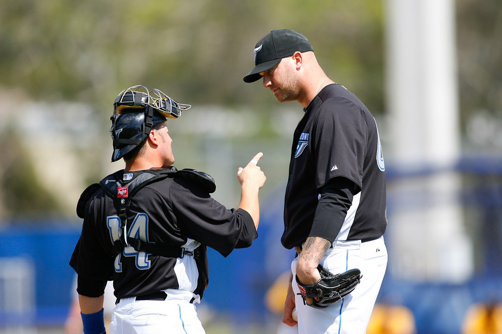 Toronto Blue Jays relief pitcher Jon Rauch (60) and Toronto Blue Jays Ryan Budde (14) talk on the pitchers mound during a Grapefruit League Spring Training Game at the Florida Auto Exchange Stadium.