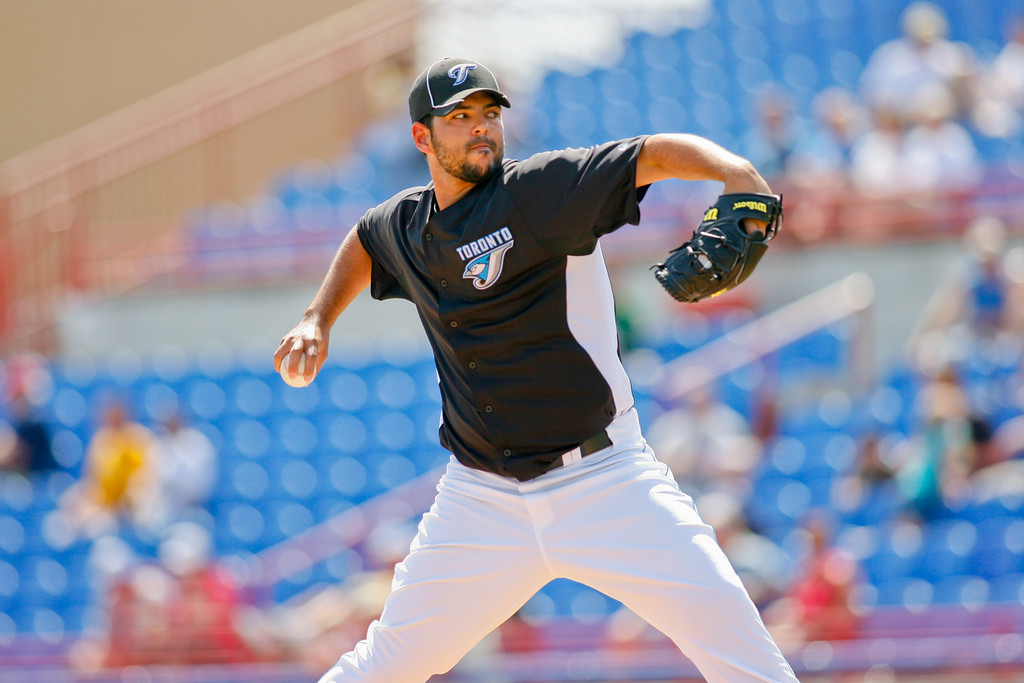 Toronto Blue Jays relief pitcher Carlos Villanueva (33) winds up for a pitchduring a Grapefruit League Spring Training Game at the Florida Auto Exchange Stadium.