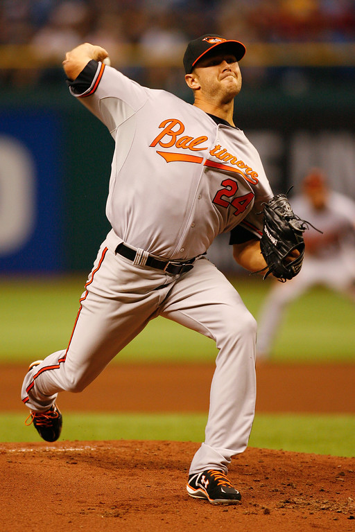 Baltimore Orioles starting pitcher Chris Tillman (24) winds up for a pitch during the game at Tropicana Field.