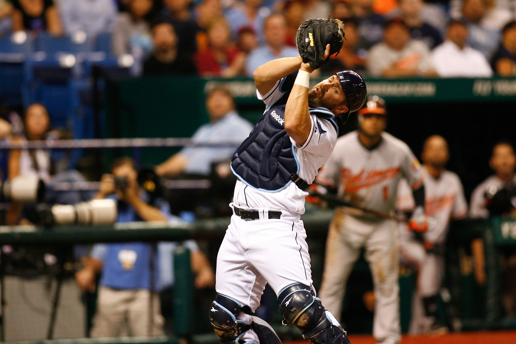 Tampa Bay Rays catcher Kelly Shoppach (10) catches a fowl ball during the game at Tropicana Field.