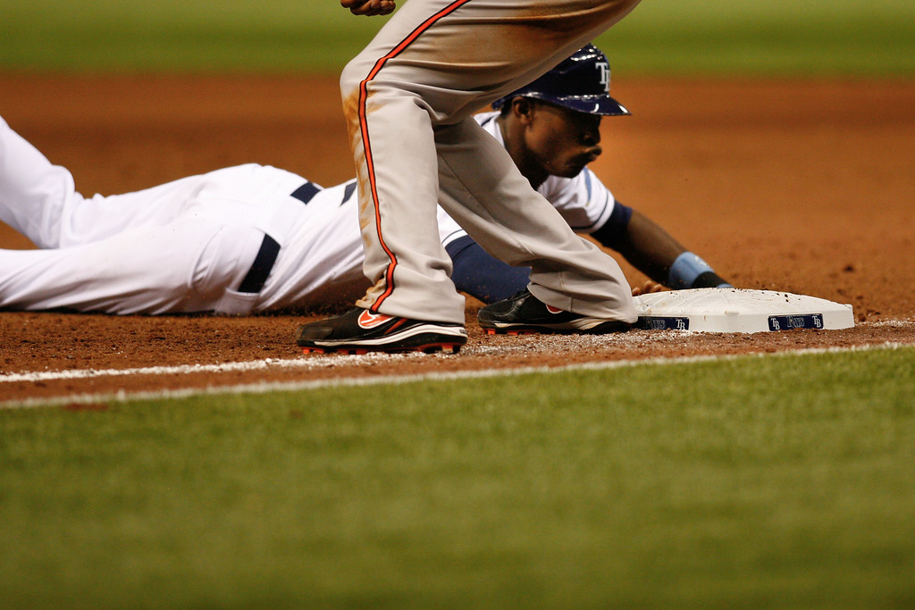 Tampa Bay Rays center fielder B.J. Upton (2) dives into first during the game at Tropicana Field.