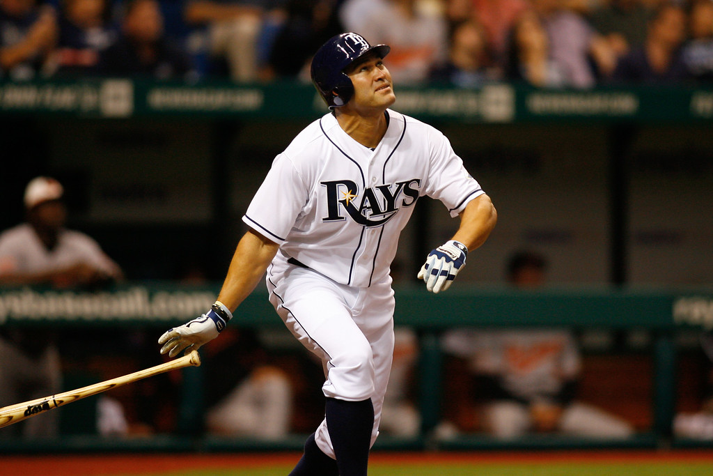 Tampa Bay Rays left fielder Johnny Damon (22) watches after hitting a pop fly during the game at Tropicana Field.