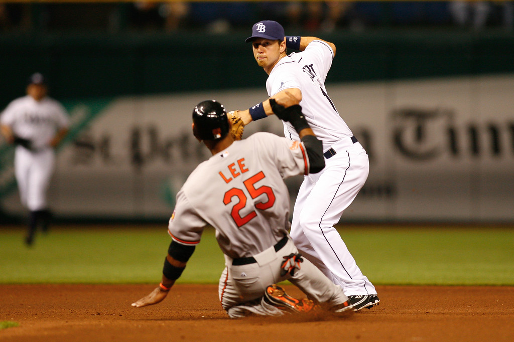 Tampa Bay Rays right fielder Ben Zobrist (18) makes the play at second as Baltimore Orioles first baseman Derrek Lee (25) slides in during the game at Tropicana Field.