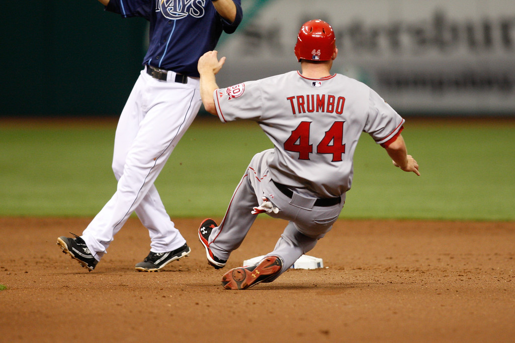 Los Angeles Angels first baseman Mark Trumbo (44) slides into second during the game at Tropicana Field.