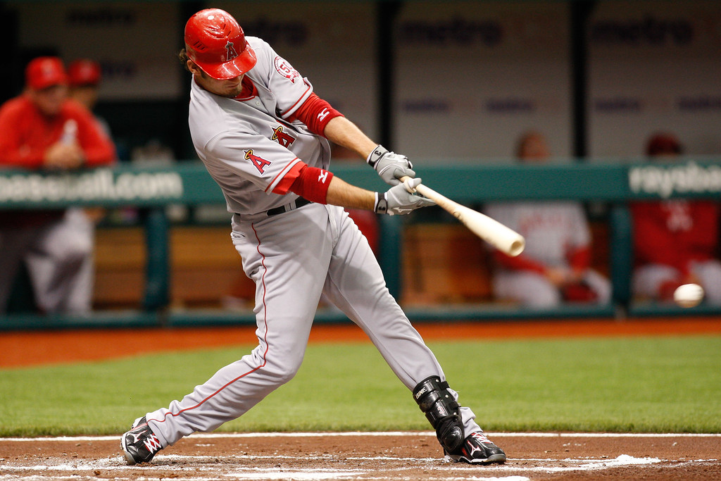 Los Angeles Angels third baseman Brandon Wood (3) makes contact while at bat during the game at Tropicana Field.