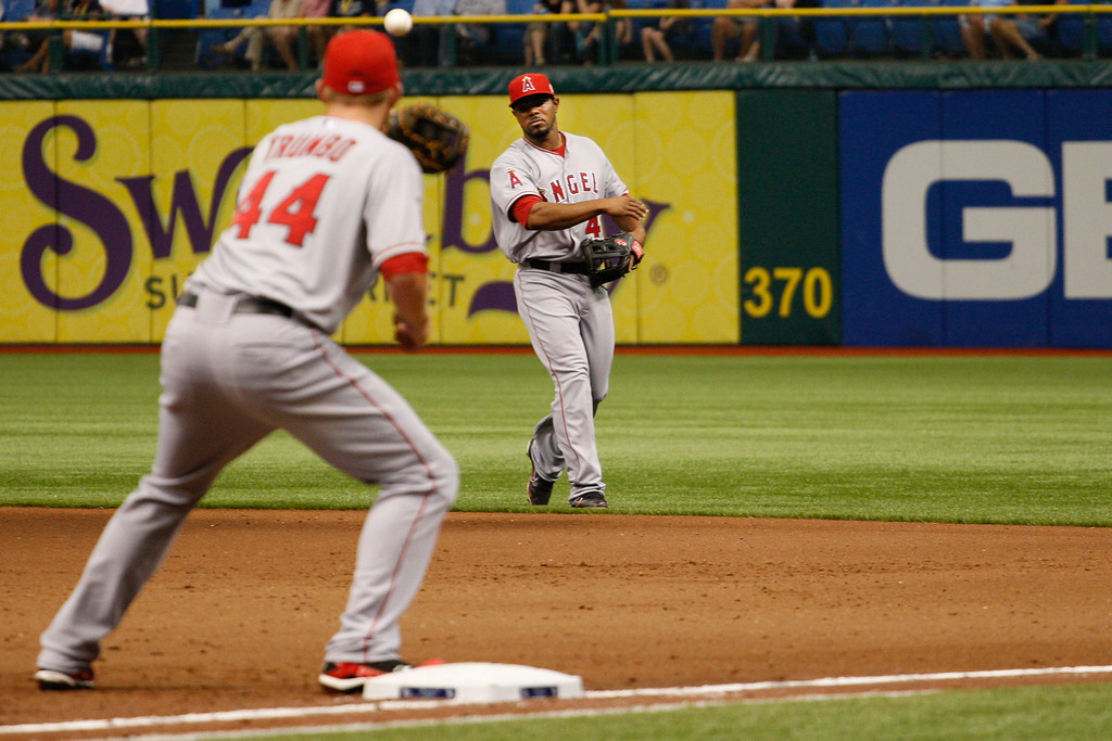 Los Angeles Angels second baseman Howard Kendrick (47) throws to Los Angeles Angels first baseman Mark Trumbo (44) to make the out at first base during the game at Tropicana Field.