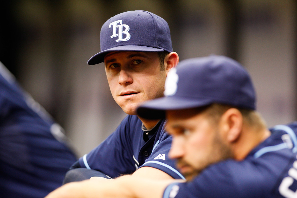 Tampa Bay Rays third baseman Evan Longoria (3) watches from the dugout during the game at Tropicana Field. Longoria is on the 15-day DL with a strained left oblique.