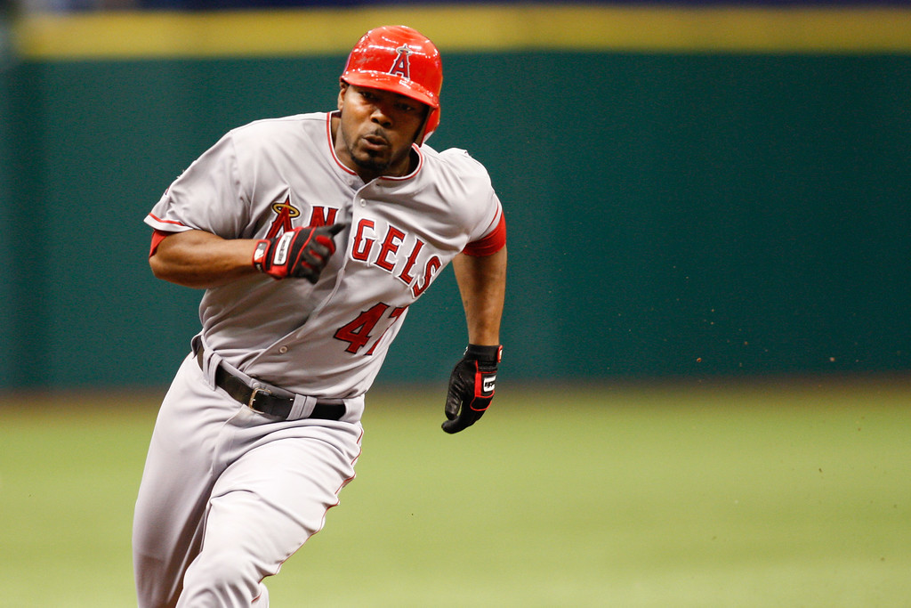 Los Angeles Angels second baseman Howard Kendrick (47) runs to third base during the game at Tropicana Field. Kendrick continued on to score.