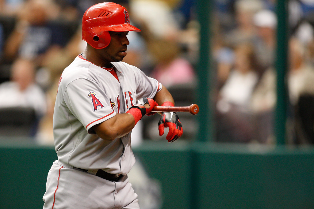Los Angeles Angels third baseman Alberto Callaspo (6) heads to the dugout after striking out during the game at Tropicana Field.