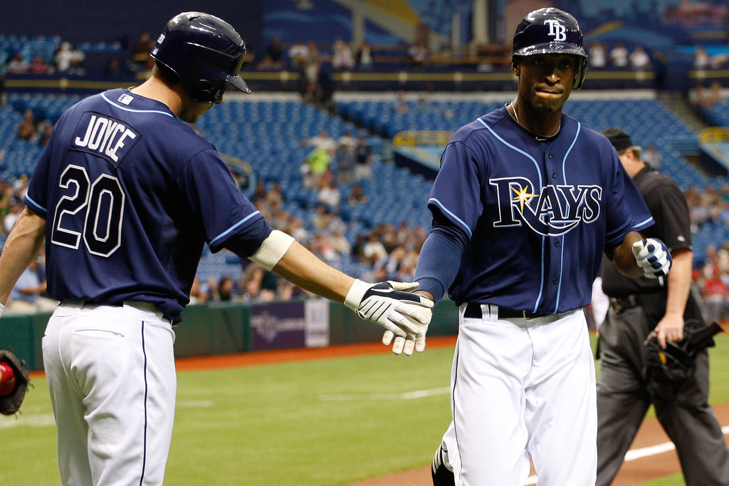 Tampa Bay Rays center fielder B.J. Upton (2) low fives Tampa Bay Rays right fielder Matt Joyce (20) after hitting a home run during the game at Tropicana Field.