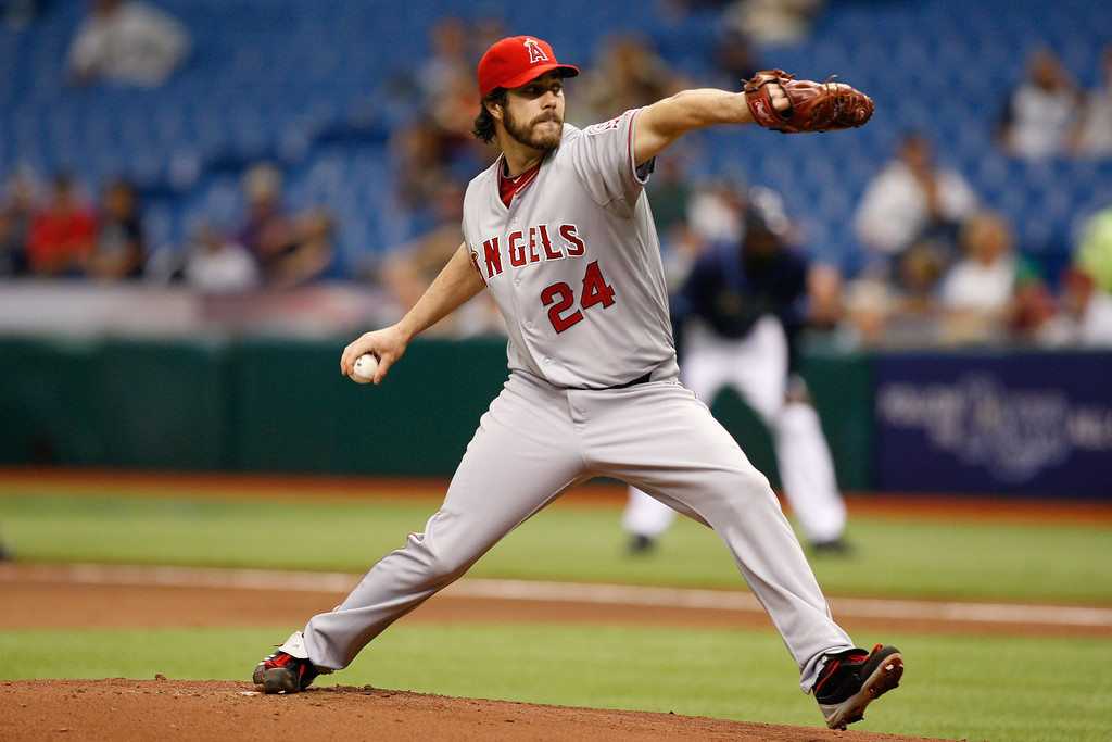 Los Angeles Angels starting pitcher Dan Haren (24) winds up for a pitch during the game at Tropicana Field.