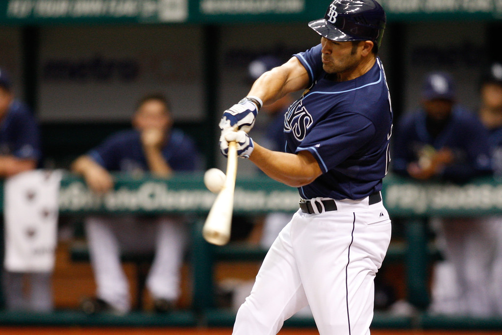 Tampa Bay Rays left fielder Johnny Damon (22) makes contact while at bat during the game at Tropicana Field.