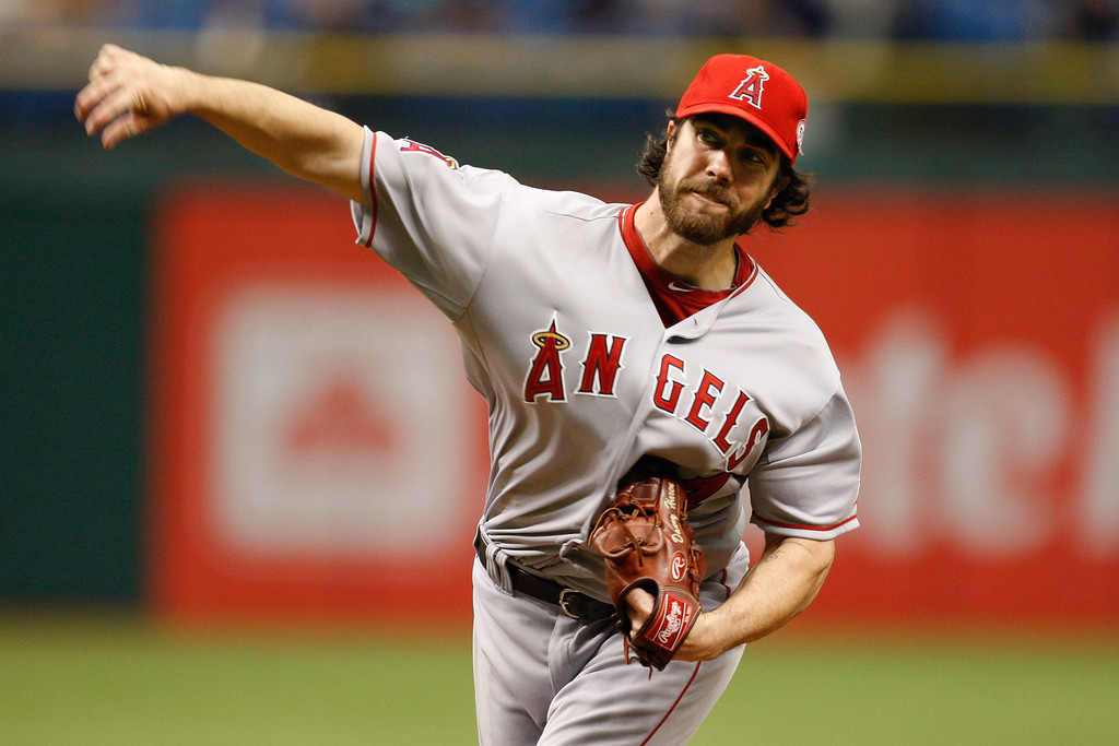 Los Angeles Angels starting pitcher Dan Haren (24) throws a pitch during the game at Tropicana Field.