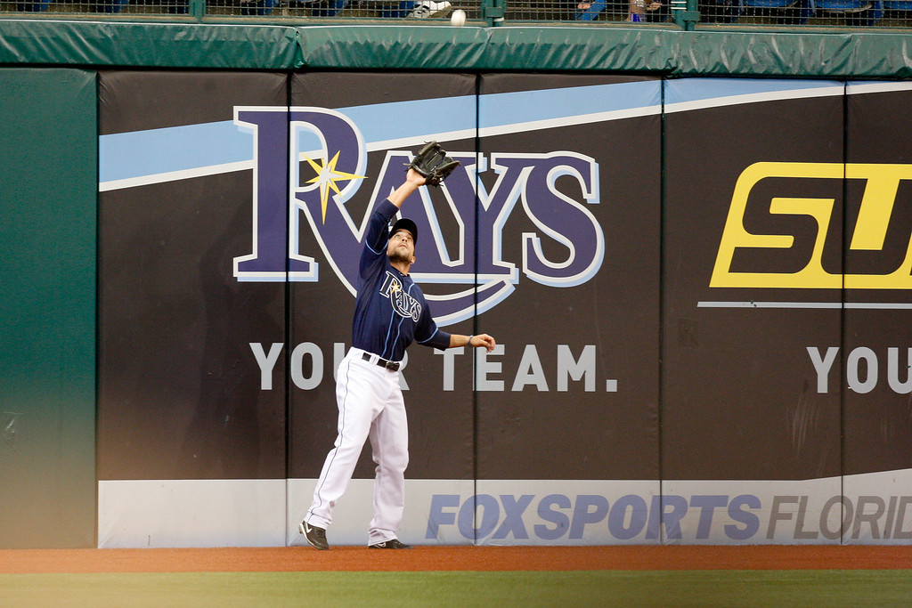 Tampa Bay Rays left fielder Sam Fuld (5) heads back to the warning track to field a fly ball during the game at Tropicana Field.