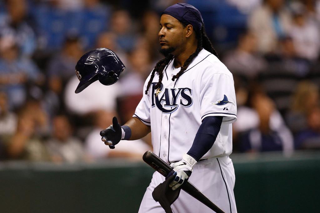 Tampa Bay Rays left fielder Manny Ramirez (24) walks of the field frustrated after striking out during the game at Tropicana Field.
