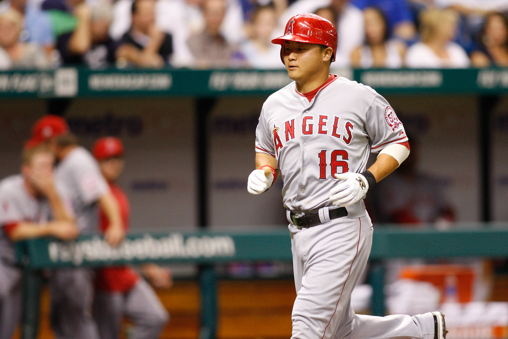 Los Angeles Angels catcher Hank Conger (16) runs to home after hiting a home run during the game at Tropicana Field.