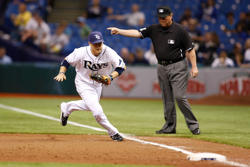 Tampa Bay Rays first baseman Dan Johnson (29) runs to first to make the out during the game at Tropicana Field.