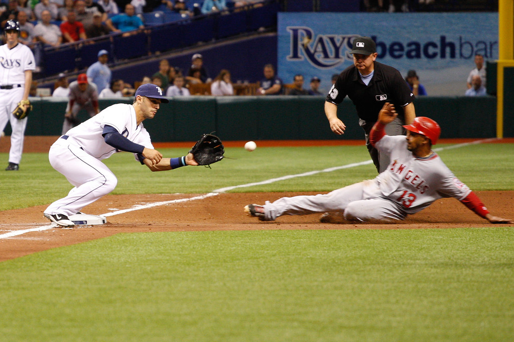 Tampa Bay Rays second baseman Sean Rodriguez (1) makes the play at thrid as Los Angeles Angels third baseman Maicer Izturis (13) slides in during the game at Tropicana Field.