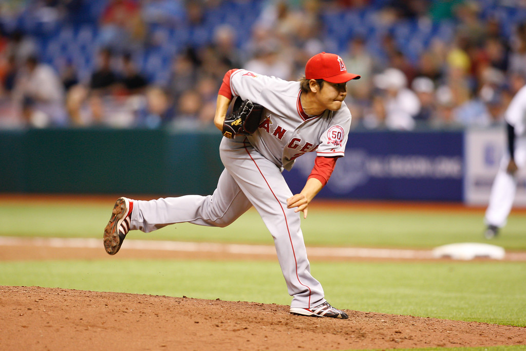 Los Angeles Angels starting pitcher Hisanori Takahashi (21) pitches during the game at Tropicana Field.