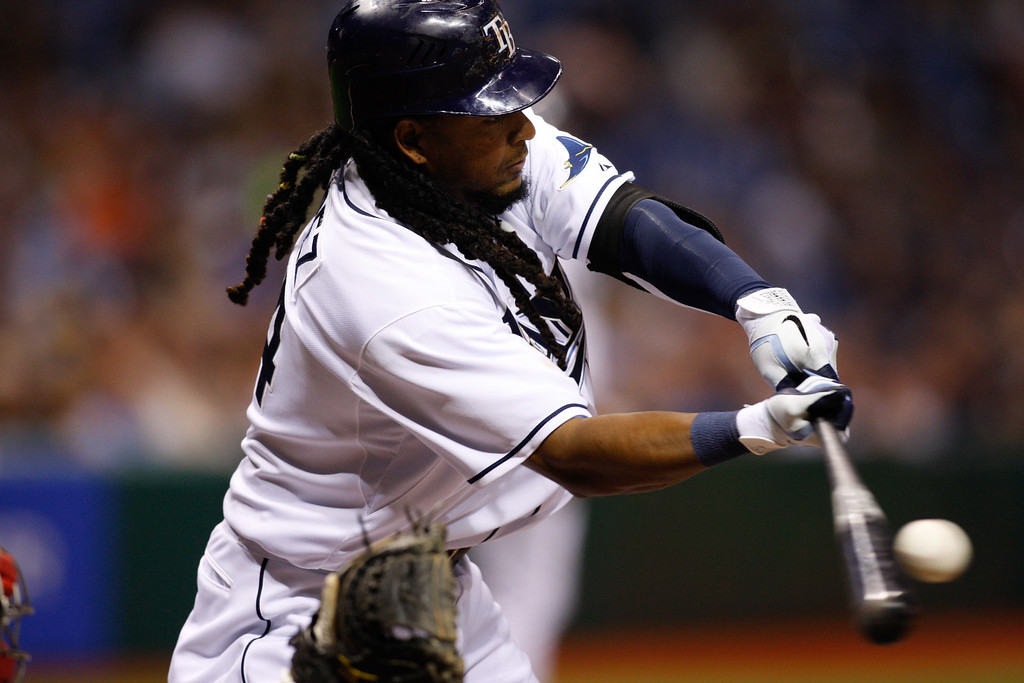 Tampa Bay Rays left fielder Manny Ramirez (24) makes contact while at bat during the game at Tropicana Field.