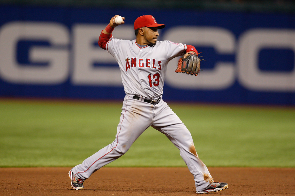Los Angeles Angels third baseman Maicer Izturis (13) throws to first to make the out during the game at Tropicana Field.