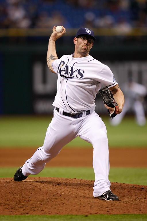 Tampa Bay Rays relief pitcher Kyle Farnsworth (43) winds up for a pitch during the game at Tropicana Field.