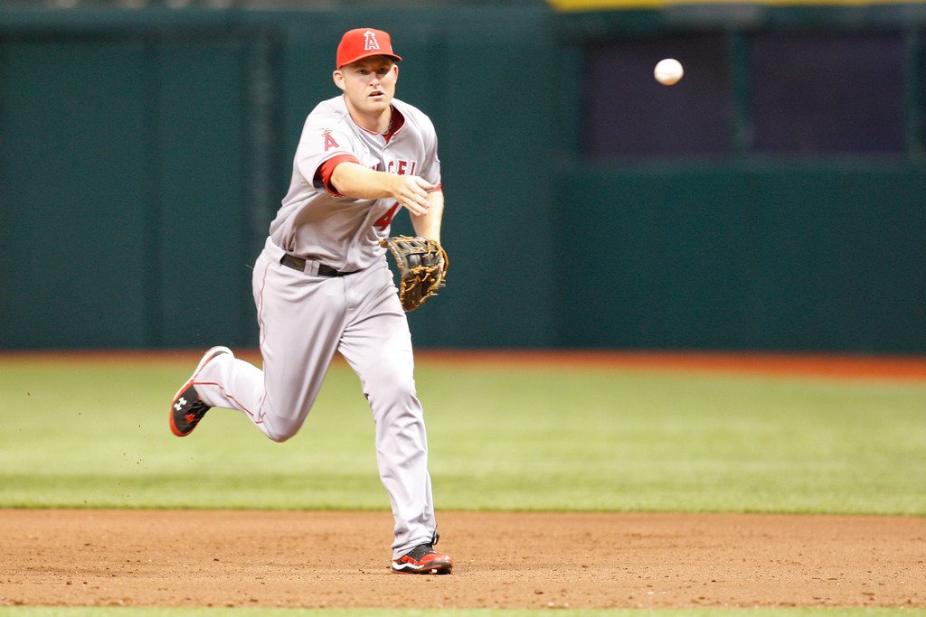 Los Angeles Angels first baseman Mark Trumbo (44) throws to first to make the out during the game at Tropicana Field.