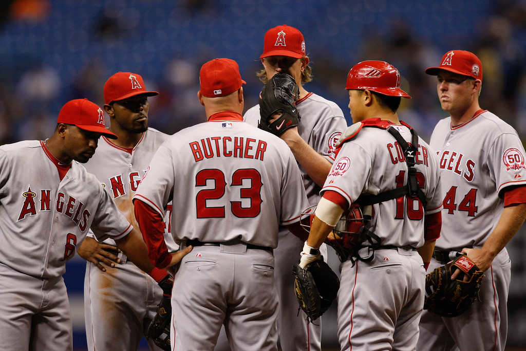 Los Angeles Angels players gather around the pitchers mound during the game at Tropicana Field.