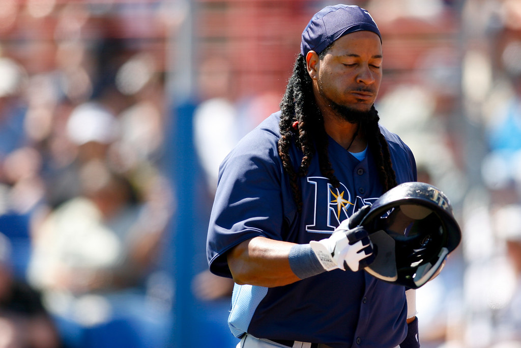Tampa Bay Rays left fielder Manny Ramirez (24) walks of the field frustrated after being struck out during a Grapefruit League Spring Training Game at the Florida Auto Exchange Stadium.