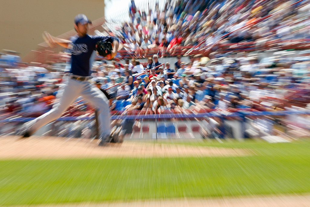 Fans watch as Tampa Bay Rays relief pitcher Dirk Hayhurst (73) winds up for a pitch during a Grapefruit League Spring Training Game at the Florida Auto Exchange Stadium.